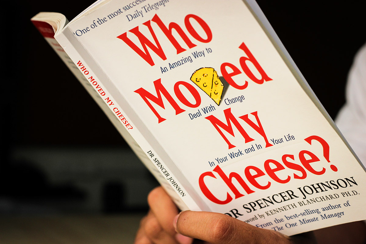 a person holding the book who moved my cheese