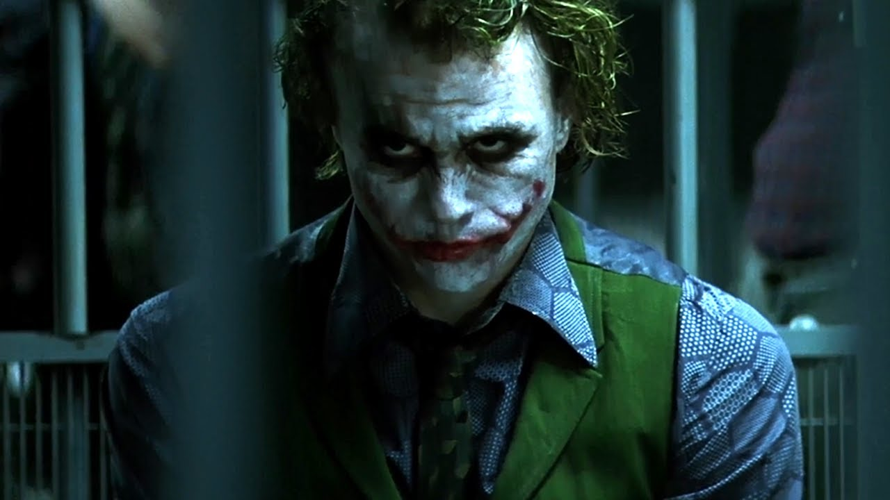 scene of the dark knight movie joker clapping